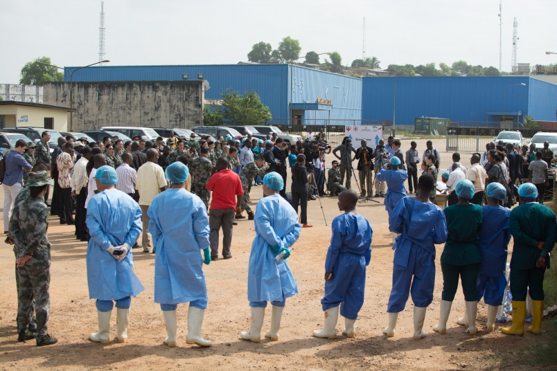 A crowd of journalists, staff of the Ebola treatment unit (ETU), and local officials gathered for the ceremony of the release of Liberia's last Ebola patient, Beatrice Yardolo, from the Chinese ETU in Monrovia, Liberia.  5 March 2015 Photo: UNMEER/Simon Ruf