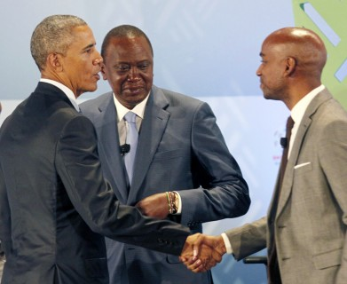 """President Barack Obama, left, shaking with Jehiel Oliver Hello tractor entrepreneur, with Kenyan President Uhuru Kenyatta, centre, after taking part in a panel discussion at the Global Entrepreneurship Summit at the United Nations Compound. Saturday, July 25, 2015, in Nairobi.  U.S. President Obama heralded Africa as a continent """"on the move"""", as he visits Kenya  Saturday, the East African nation where he has deep family ties. (AP Photo/Khalil Senosi)"""