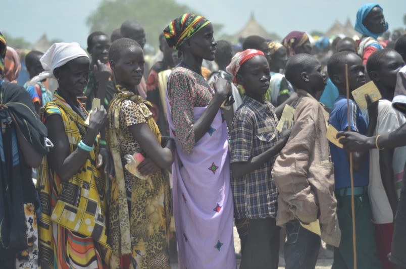 In this photo taken on Saturday, July 25, 2015, People waiting for food distribution in Dablual. Soldiers believed to be South Sudanese government troops and allied militia stole relief food and killed seven people in an attack in a rebel-held part of Unity state, a local official said Thursday. The attack happened Monday in the village of Dablual. (AP Photo/Jason Patinkin)