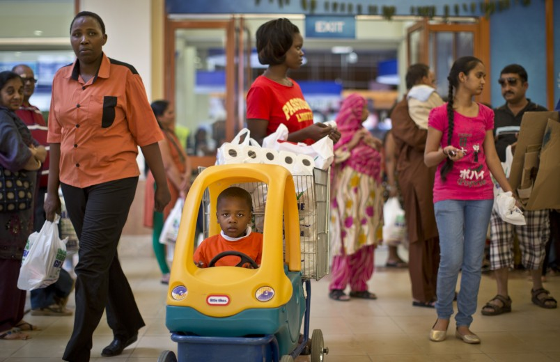A boy plays in a supermarket shopping cart as other shoppers visit the reopened Westgate Shopping Mall, nearly two years after a terrorist attack there left at least 67 people dead, in the capital Nairobi, Kenya Saturday, July 18, 2015. Hundreds of shoppers thronged through the reopened mall Saturday, following two years of repairs after security forces battled four gunmen from Somalia's al-Qaida-linked al-Shabab militant group there in September 2013. (AP Photo/Ben Curtis)