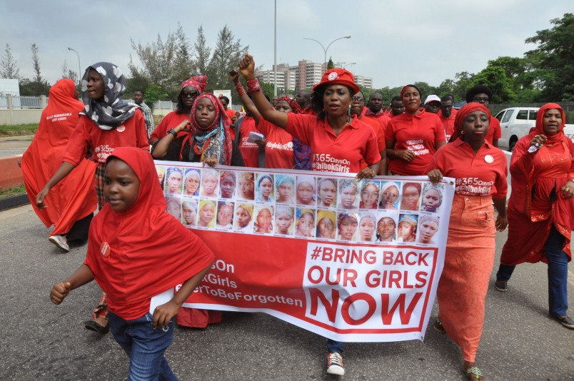 People take part in a march that is part of the 'Bring Back Our Girls' campaign, in memory of the Nigerian girls abducted by Nigerian extremists, outside the presidential residence in Abuja, Nigeria, Wednesday, July 8, 2015. Nigeria's Boko Haram extremists are offering to free more than 200 young women and girls kidnapped from a boarding school in the town of Chibok in exchange for the release of militant leaders held by the government, a human rights activist has told The Associated Press. (AP Photo/Olamikan Gbemiga)