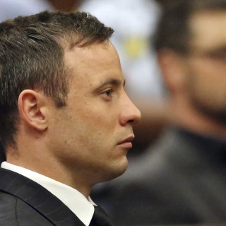 FILE - In this Tuesday, Oct, 2014 file photo, Oscar Pistorius sits in the dock in court in Pretoria South Africa. Judge Thokozile Masipa ruled Wednesday, Dec 10, 2014 that prosecutors can appeal the culpable homicide conviction of Oscar Pistorius, who was acquitted of murdering girlfriend Reeva Steenkamp. (AP Photo/(AP Photo/Themba Hadebe, Pool, File)