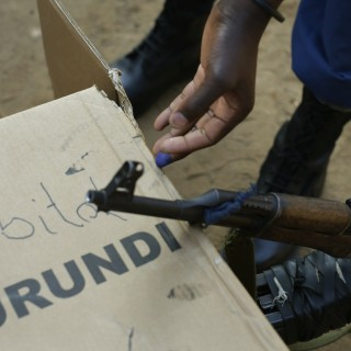 A soldier tries to erase the ink on his finger after he cast his vote in the presidential elections in Bujumbura, Burundi, Tuesday July 21, 2015. A low turnout was experienced in several polling stations in the Burundi's capital at the start of voting in the country's presidential election following a night of explosions and gunfire in at least two opposition strongholds that oppose President Pierre Nkurunziza's candidacy for a third term in office. (AP Photo/Jerome Delay)