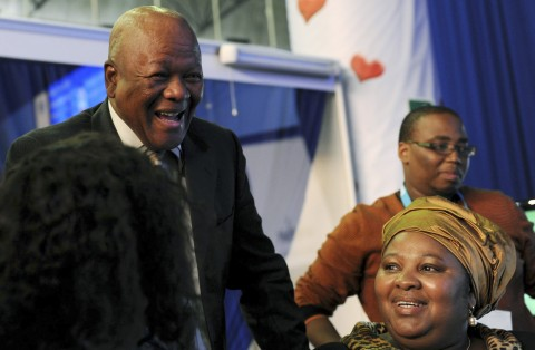 Jeff Radebe, South African Minister of Justice and Constitutional Development, left, reacts to the latest election results with Minister of Correctional Services Nosiviwe Mapisa-Nqakula, right, as results rolled in after local municipal elections, at the results center in Pretoria, South Africa, Thursday, May 19, 2011. The African National Congress was topping the leader board with their official opposition, the Democratic Alliance in second position. (AP Photo)