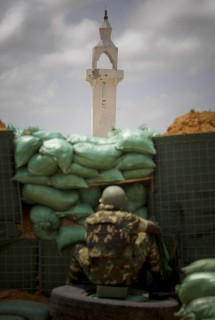 In this photo released by the African Union-United Nations Information Support Team Thursday Aug.18, 2011, a Burundian soldier serving with the African Union Mission in Somalia (AMISOM) mans a forward position facing the minuret of a mosque in northern Mogadishu near the old cigarette and match factory where AMISOM have estblished a new position following the sudden departure from the Somali capital of the insurgent extremist group Al Shabaab two weeks ago. Although still in control of large swathes of central and southern Somalia, Al Shabaab's overnight withdrawal was in part due to string of military offensives this year by AMISOM and the forces of the UN-backed Transitional Federal Government (TFG) which has seen them take strategic and tactical positions and areas of the capital that is now almost all under TFG and AMISOM contro (AP Photo/ AU-UN IST/ STUART PRICE.)