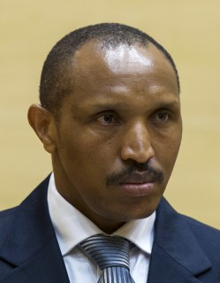 Bosco Ntaganda, a Congo militia leader known as The Terminator, waits for the start of his trial at the International Criminal Court on charges including murder, rape and sexual slavery allegedly committed in the eastern Ituri region of Congo from 2002-2003, in The Hague, Netherlands, Wednesday, Sept. 2, 2015. (Michael Kooren/Pool Photo via AP)