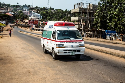 An ambulance drives on a deserted street as Sierra Leone enters the second day of a three day country wide lockdown on movement of people due to the Ebola virus in the city of Freetown, Sierra Leone, Saturday, March 28,  2015. Guinea has deployed security forces to the country's southwest in response to reports that Sierra Leoneans are crossing the border to flee an Ebola lockdown intended to stamp out the deadly disease, an official said Saturday. (AP Photo/ Michael Duff)