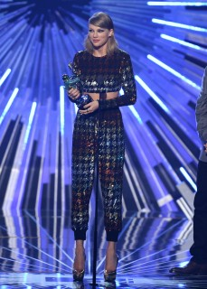 """Taylor Swift accepts the award for female video of the year for """"Blank Space"""" at the MTV Video Music Awards at the Microsoft Theater on Sunday, Aug. 30, 2015, in Los Angeles. (Photo by Matt Sayles/Invision/AP)"""