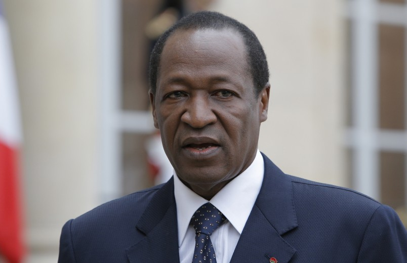 FILE - This is a Tuesday, Sept, 18, 2012  file photo of Burkina Faso President Blaise Compaore speaks to the media after a meeting with France's President Francois Hollande at the Elysee Palace in Paris.  President Blaise Compaore stepped down Friday Oct. 31, 2014 after 27 years in power and said elections would be held in 90 days following a wave of protests against his rule.  The announcement, read out on television, was a sharp about-face from the day before, when protesters stormed the parliament but Compaore vowed to hold power through next year. (AP Photo/Francois Mori, File)