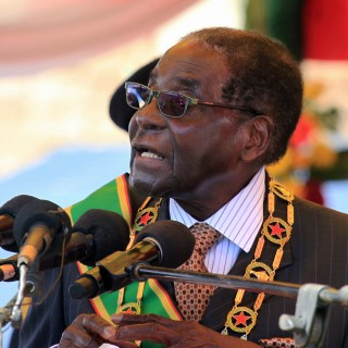 """FILE - In this Monday, Aug. 10, 2015 file photo Zimbabwean President Robert Mugabe delivers his speech during a ceremony to honour thousands of fighters who died in the 1970s Bush war  against colonialism, in Harare. Zimbabwe is """"frantically working"""" to repatriate from Britain skulls of indigenous people killed in an 1890s anti-colonialism war, said a Cabinet minister. The state-run Herald newspaper Saturday quoted Home Affairs Minister Ignatius Chombo saying Zimbabwe will talk to its former colonial ruler over the skulls reportedly held by Britain's Natural History Museum. (AP Photo/Tsvangirayi Mukwazhi, File)"""