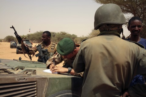 In this photo taken June 23, 2015, French forces disarm a man during a patrol in the desert of Northern Mali along the border with Niger on the outskirts of Asongo, Northern Mali. French forces help to disarm groups in northern Mali after a peace deal reached. (AP Photo/Maeva Bambuck )