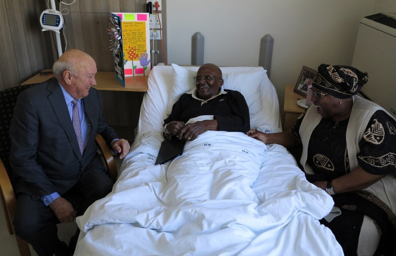In this photo supplied by Oryx Media, former president F.W. de Klerk, left, visits Anglican Archbishop Desmond Tutu, center, with wife, Leah Tutu right, in a Cape Town, South Africa hospital Thursday, Sept. 3, 2015. Tutu's foundation said Friday Sept. 4, 2015, that the retired Tutu had left hospital after receiving treatment for nearly three weeks.  (Benny Gool/Oryx Media via AP)