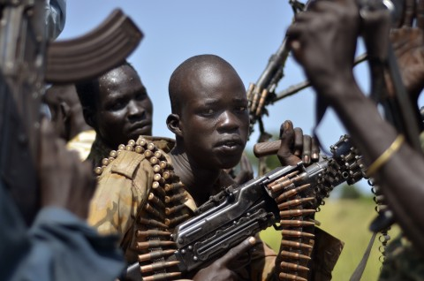 South Sudan government soldiers in the town of Koch, Unity state, South Sudan, Friday, Sept. 25, 2015. The regional bloc that mediated South Sudan's peace agreement says both sides have violated the deal signed last month. (AP Photo/Jason Patinkin)