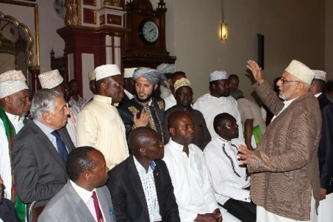 A Muslim cleric addresses fellow worshippers and Christian leaders during the interfaith service at Jamia Mosque in Nairobi