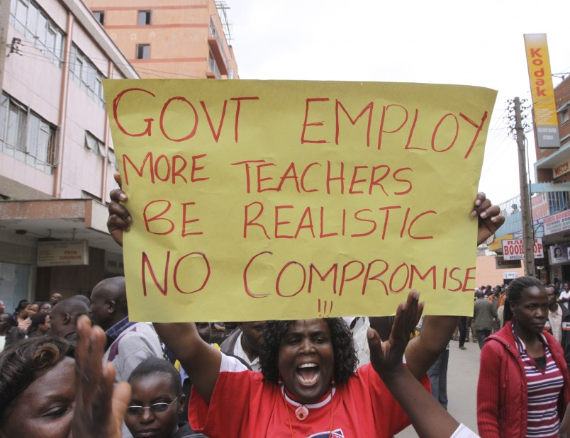 Kenya Teachers marching in the street  of  Nairobi during the  Strike holding  banners  in  Nairobi, Kenya,Tuesday Sept, 6. 2011. More than 200,000 Kenyan teachers went on strike on Tuesday to protest the diversion of government funds meant to hire more teachers for overcrowded classrooms, said the chairman of the country's biggest teaching union. The money has gone to the ministry of defense instead, whose spending is not publicly scrutinized.(AP Photo/Khalil Senosi)