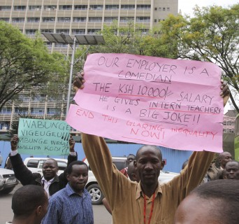 Kenya Teachers protest in the streets of Nairobi during their strike holding banners in Nairobi Tuesday Sept. 6, 2011.  The chairman of the Kenya National Union of Teachers says 200,000 teachers in schools have started a strike to protest the diversion of funds meant to hire more teachers and ease classroom overcrowding, in a move expected to affect more than 10 million children.(AP Photo/Khalil Senosi)