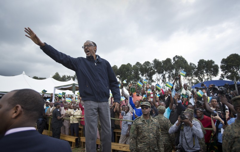 Rwanda's President Paul Kagame waves to the crowd before speaking at a baby gorilla naming ceremony in Kinigi, northern Rwanda, Saturday, Sept. 5, 2015. Rwanda has named two dozen baby mountain gorillas in an annual naming ceremony that reflects the African country's efforts to protect the endangered animals, which attract large numbers of foreign tourists to the volcano-studded forests where they live. (AP Photo/Ben Curtis)