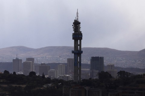 The Lukasrand Tower with the Telkom branding is photographed in Pretoria, South Africa, Tuesday Aug. 7, 2012. A government tribunal fined South Africa's Telkom SA Ltd. $54.8 million over a decade long case alleging the company used its monopoly to put unfair prices on its competitors. (AP Photo/Denis Farrell)