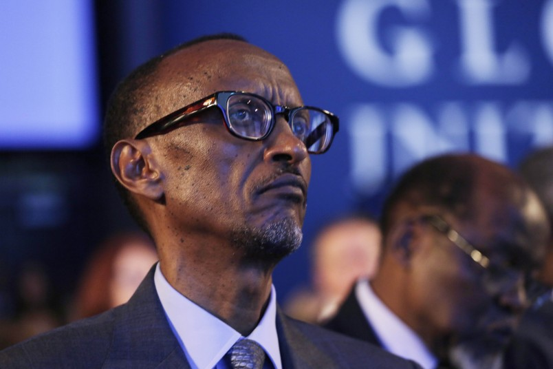"""Paul Kagame, president of Rwanda, listens while seated in the audience at the Clinton Global Initiative, Monday, Sept. 22, 2014 in New York. The session is called """"Reimagining Impact."""" (AP Photo/Mark Lennihan)"""