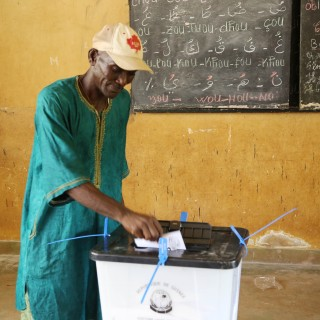 A man casts his vote during presidential elections in the Bambeto neighbourhood of Conakry, Guinea, Sunday, Oct. 11, 2015. Guinea's president and main opposition candidate called for calm Sunday when they voted in the country's presidential election, after days of electoral clashes. (AP Photo/Youssouf Bah)
