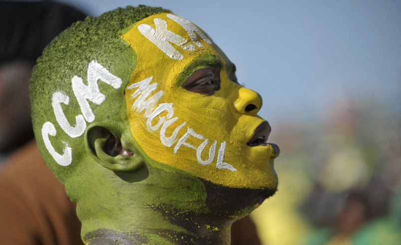 A supporter wears facepaint on which is written the initials of the ruling Chama Cha Mapinduzi (CCM) party, and the surname of their presidential candidate John Magufuli, at an election rally in Dar es Salaam, Tanzania Friday, Oct. 23, 2015. Tanzanians vote Sunday in landmark elections that could end the dominance of the ruling party, which has held power for decades but faces a united opposition buoyed by growing discontent over official corruption. (AP Photo/Khalfan Said)