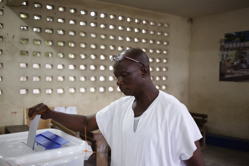 A man casts his ballot during elections in Abidjan, Ivory Coast, Sunday Oct. 25, 2015.  Ivory Coast's president Alassane Ouattara is widely expected to win a second term as the West African nation votes, five years after a disputed poll that spilled over into the worst violence the country has experienced since independence.(AP Photo/Schalk van Zuydam)