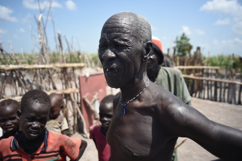 In this photo taken on Saturday, July 25, 2015, James Gatmai Yoah, in Dablual, South Sudan, who has been living on leaves to survive. His home was burned in a previous attack. Soldiers believed to be South Sudanese government troops and allied militia stole relief food and killed seven people in an attack in a rebel-held part of Unity state, a local official said Thursday. The attack happened Monday in the village of Dablual. (AP Photo/Jason Patinkin)
