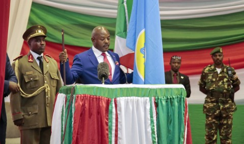 Burundi's President Pierre Nkurunziza is sworn in for a third term at a ceremony in the parliament in Bujumbura, Burundi, Thursday, Aug. 20, 2015. Without any fanfare or even a public announcement beforehand, Nkurunziza was sworn in for a third term on Thursday in this central African country which has been plagued by political violence that has left more than 100 people dead and tens of thousands of refugees. (AP Photo/Gildas Ngingo)