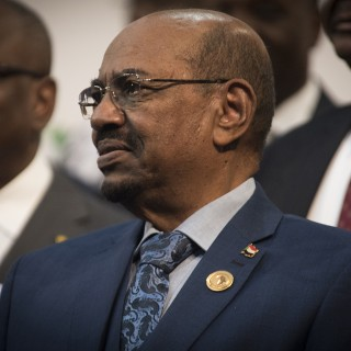 Sudanese president Omar al-Bashir is seen during a photo op at the African Union summit in Johannesburg, Sunday June 14 2015. A South African judge on Sunday ordered authorities to prevent al-Bashir from leaving the country because of an international order for his arrest, human rights activists said.(AP Photo/Shiraaz Mohamed)