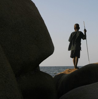 A young Malawi boy watches fishermen pick their catch on the shores of Lake Malawi, Malawi, Wednesday Aug. 1, 2007. Lake Malawi is is the most southerly lake in the Great African Rift Valley system and the third largest in Africa. (AP Photo/Jerome Delay)