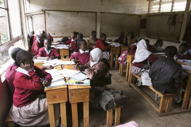 Pupils at the Toi Primary School in Nairobi, Kenya, Tuesday Sept. 6, 2011,  sit in a classroom and study without a teacher, because the teachers are on strike.  The chairman of the Kenya National Union of Teachers says 200,000 teachers in schools have started a strike to protest the diversion of funds meant to hire more teachers and ease classroom overcrowding, in a move expected to affect more than 10 million children. (AP Photo/Khalil Senosi)