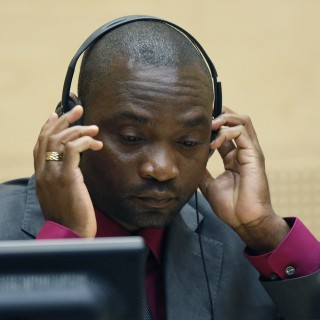 Germain Katanga, a Congolese national, sits in the courtroom of the ICC during the closing statements in the trial against Katanga and Mathieu Ngudjolo in The Hague, Netherlands, Tuesday May 15, 2012.  Prosecutors at the International Criminal Court are urging judges to convict two Congolese warlords of commanding fighters who wiped out a village in 2003, killing more than 200 civilians, including women children and the elderly. (AP Photo/Michael Kooren, Pool)