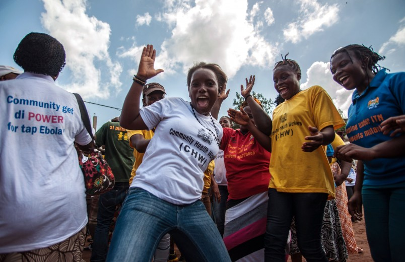 Women celebrate as their country is declared Ebola free in the city of Freetown Sierra Leone, Saturday, Nov. 7,  2015. The World Health Organization declared Sierra Leone free from Ebola transmissions on Saturday, as West Africa battles to stamp out the deadly virus that is holding on in neighboring Guinea. (AP Photo/Aurelie Marrier d'Unienvil)