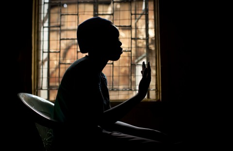 In this photo taken Monday, Feb. 16, 2015, a 16-year-old HIV-positive Kenyan girl whose mother died from AIDS-related complications, recounts her experiences on condition of anonymity because of her age and to avoid stigma in her community, at a center run by a Kenyan non-governmental organization in the Korogocho slum neighborhood of Nairobi, Kenya. AIDS has become the leading cause of death for adolescents in Africa and the second leading cause of death among adolescents globally, global health agencies said Tuesday. (AP Photo/Ben Curtis)