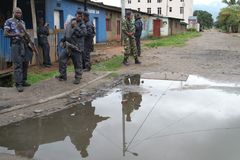 Burundian police and soldiers guard a deserted street in Bujumbura, Burundi, Sunday, Nov. 8, 2015. Witnesses say seven people have been killed in an overnight attack at a bar in the violence-prone Burundi capital, Bujumbura.  Witnesses on Sunday said they heard gunshots Saturday night at a bar in the Kanyosha neighborhood of Bujumbura, and later found bloodied bodies lying on the floor. (AP Photo)