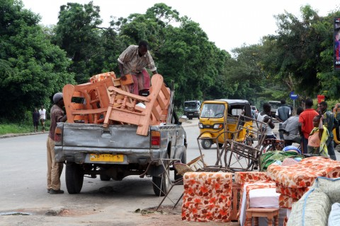 Burundians load belongings on a truck in Bujumbura, Burundi, Saturday, Nov. 7, 2015. Carrying their prized possessions, scores of people fled Burundi's capital Saturday before a looming security crackdown that has left many predicting more bloody violence ahead.  (AP Photo)