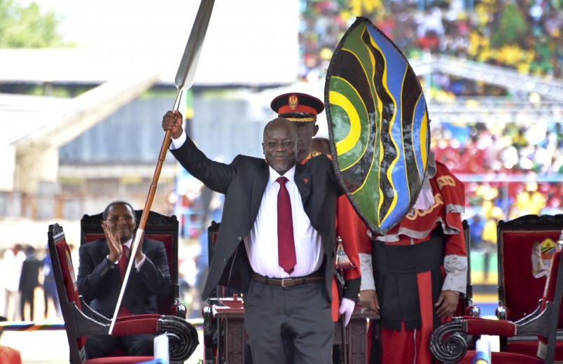 Tanzania's new President John Pombe Magufuli holds up a ceremonial spear and shield to signify the beginning of his presidency, shortly after swearing an oath during his inauguration ceremony at Uhuru Stadium in Dar es Salaam, Tanzania Thursday, Nov. 5, 2015. John Pombe Magufuli was sworn in Thursday as the country's fifth president in a ceremony attended by several African heads of state but boycotted by the country's opposition which says the vote was rigged. (AP Photo/Khalfan Said)