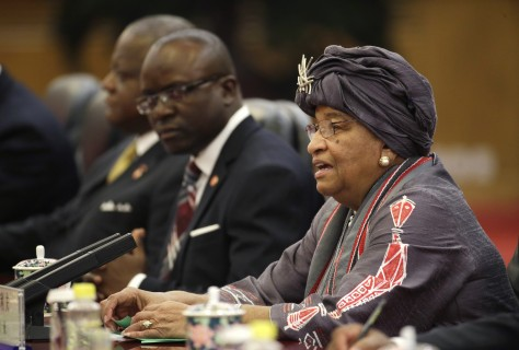 Liberia's President Ellen Johnson Sirleaf holds a talk with China's President Xi Jinping, during a meeting at the Great Hall of the People in Beijing, China, Tuesday, Nov. 3, 2015. (Jason Lee/Pool Photo via AP)