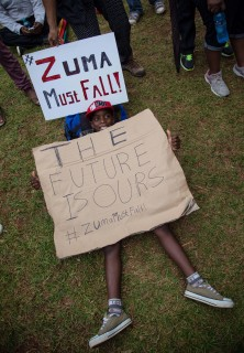 Demonstrators take part in a protest at the government's Union Buildings in Pretoria, South Africa, Wednesday, Dec. 16, 2015. The protesters were calling for president Jacob Zuma to be removed amid allegations of corruption, maladministration and the hiring and firing of three finance ministers in a week. (AP Photo/Jaques Nelles)