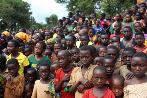 In this photo taken on Tuesday, Dec. 29 2015, Burundian refugees attend a rally addressed by Tanzania Prime Minister Kassim Majaliwa, at Nduta refugee camp in Kigoma, Tanzania. Burundi's President Pierre Nkurunziza threatened on Wednesday, Dec. 30 to fight any African Union peacekeepers imposed on his country, in his most confrontational comments yet on a mounting political crisis. The African Union said this month it was ready to send 5,000 peacekeepers to protect civilians caught up in months of violence, invoking for the first time powers to intervene in a member state against its will.  (AP Photo)