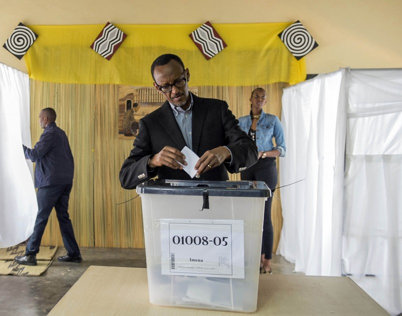 President of Rwanda, Paul Kagame posts his ballot,  in Kigali, Friday, Dec. 18, 2015. Rwandans are voting in a referendum to decide if President Paul Kagame should be allowed to extend his time in power. Kagame, 58, is ineligible to run in 2017 because the Rwandan constitution limits a president to two terms. But if Rwandans vote to change the term restriction, Kagame would be able to run for an additional seven-year term and then two-five terms. He could possibly stay in power until 2034. (AP Photo)