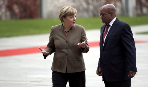 German Chancellor Angela Merkel, left, and the President of South Africa Jacob Zuma, right, talk during a military welcome ceremony at the chancellery in Berlin, Germany, Tuesday, Nov. 10, 2015. (AP Photo/Michael Sohn)