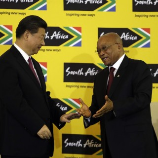 South African President Jacob Zuma, right, shakes hand with Chinese President Xi Jinping, left, after their joint media conference at Union Building Pretoria, South Africa, Wednesday, Dec. 2, 2015.  (AP Photo/Themba Hadebe)