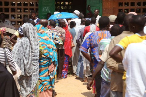 People stand in line to cast their ballots, during elections in Bangui, Central African Republic, Wednesday, Dec. 30, 2015. Thousands in Central African Republic's capital voted Wednesday in national elections with hope that a new president will lead to greater stability after years of violence. (AP Photo/Herve Serefio Diaspora)