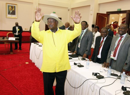 Ugandan President, Yoweri Museveni, , centre, gestures to delegates attending the Burundi peace talks, at Entebbe State House about 42 kilometers east of Uganda capital Kampala, Monday, Dec. 28, 2015. Representatives of Burundi's government and the opposition are in Uganda for negotiations aimed at ending political violence. Burundian President Pierre Nkurunziza, whose decision to run for election to a third term triggered the bloodshed, wasn't present at the opening ceremony Monday. (AP Photo/Stephen Wandera)
