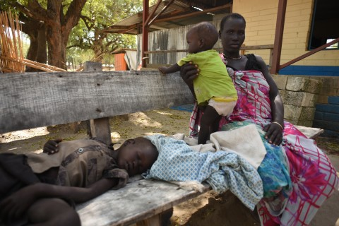Nyawel Top sits with her two sick children in a Doctors Without Borders clinic in Leer town, South Sudan on Tuesday Dec. 15,  2015. Tuesday marks the 2 year anniversary of South Sudan's civil war. The food distribution was the first to take place in Leer since July, and the area is experiencing famine conditions. Tuesday marked the 2 year anniversary of South Sudan's civil war.(AP Photo/Jason Patinkin)