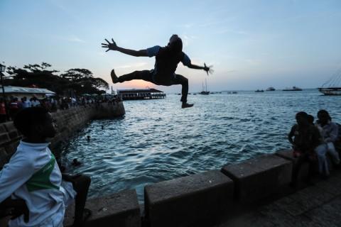 Zanzibari youth jump into the Indian Ocean from Forodhani Gardens park in the historical city of Stone Town, Zanzibar, Tanzania, on Wednesday, Jan. 21, 2015. (AP Photo/Mosa'ab Elshamy)