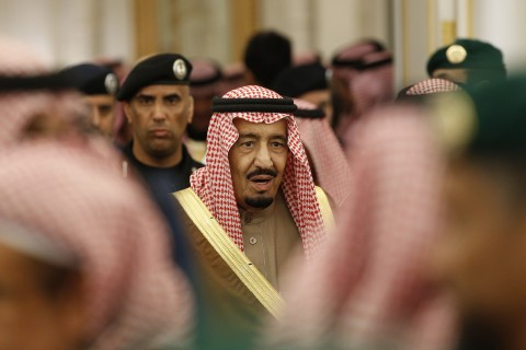 FILE - In this Jan. 24, 2015 file photo, Saudi Arabia's King Salman attends a ceremony at the Diwan royal palace in Riyadh. Within hours of ascending to the Saudi throne, King Salman announced sweeping changes that would recast the kingdom's line of succession, and rework its security and economic decision-making processes. It marked the start of what would be a tumultuous year for King Salman, who completes one year as monarch on Saturday, Jan. 23, 2016. (AP Photo/Yoan Valat, Pool, File)