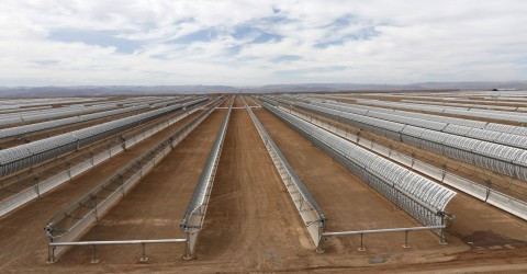 Construction of Morocco's Noor I solar power plant,  is nearing completion near Ouarzazate, Morocco, Friday April, 24, 2015 . The facility will use parabolic mirrors to catch the sun's rays to heat a salt solution and drive steam turbines to create power. (AP Photo/Abdeljalil Bounhar)