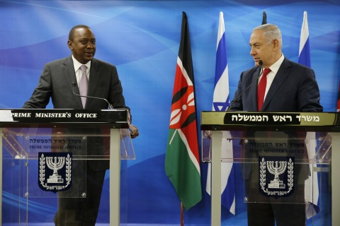 Kenya's President Uhuru Kenyatta, left, stands next to Israeli Prime Minister Benjamin Netanyahu as they deliver joint statements in Jerusalem, Tuesday, Feb. 23, 2016. The two leaders signed a joint statement on water that focuses on cooperation on water and agricultural issues and establishes a joint bilateral committee. (Amir Cohen, Pool via AP)
